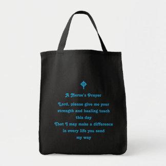 El rezo de una enfermera bolsa de mano