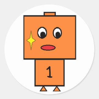 el robot_orange añade el texto pegatina redonda