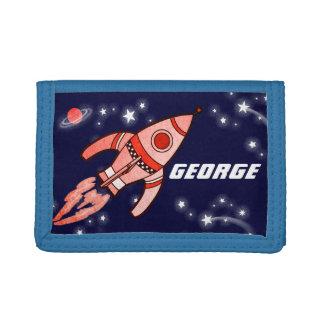 El rojo azul del cohete de espacio de los muchacho