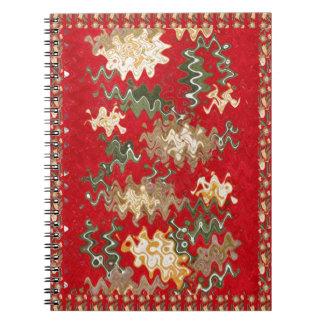 El rojo chino oriental agita texturas de seda de cuaderno