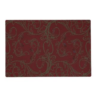 El rojo de ladrillo y la voluta de color topo de tapete individual