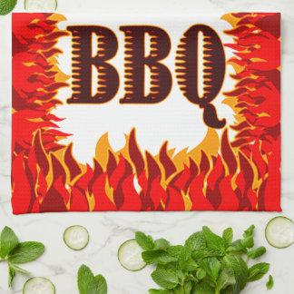 El rojo del Bbq flamea la toalla de cocina