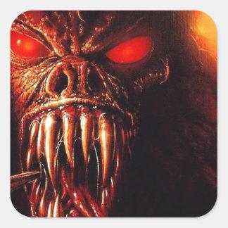 el rojo del monstruo observa con los colmillos pegatina cuadrada
