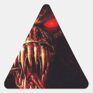 el rojo del monstruo observa con los colmillos pegatina triangular