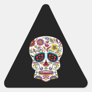 El rojo florece el cráneo mexicano del azúcar del pegatina triangular