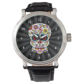 El rojo florece el cráneo mexicano del azúcar del relojes de mano