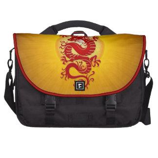 El rojo y el amarillo estallaron el dragón chino bolsas de ordenador