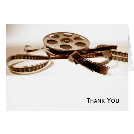 El rollo de película en sepia entona el fondo felicitacion