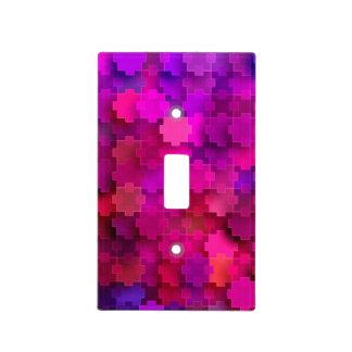 El rompecabezas cuadrado rosado y azul junta las tapas para interruptores