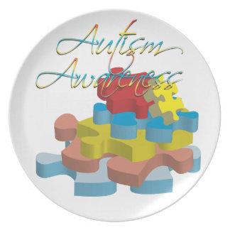 El rompecabezas de la conciencia del autismo junta plato para fiesta