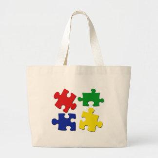 El rompecabezas junta las piezas del bolso bolsas lienzo