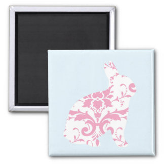 El rosa adorna la silueta del conejito imanes