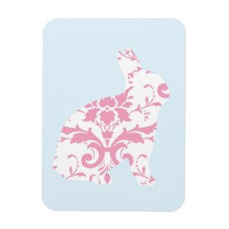 El rosa adorna la silueta del conejito imán de vinilo