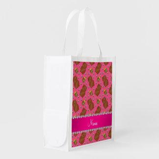 El rosa conocido lleva el modelo de las abejas de bolsas de la compra
