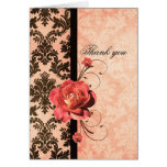 El rosa coralino del damasco elegante de lujo le felicitacion