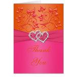 El rosa, los corazones unidos florales anaranjados tarjeta