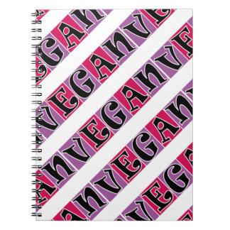 El rosa púrpura del vegano bloquea el cuaderno