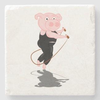 El saltar lindo del cerdo del dibujo animado posavasos de piedra