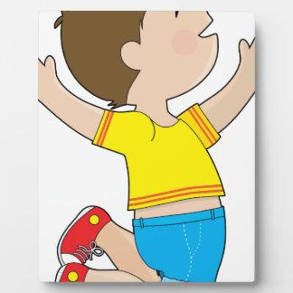 El salto del muchacho placa para mostrar