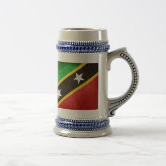 El santo San Cristobal/Nevis señala por medio de u Jarra De Cerveza