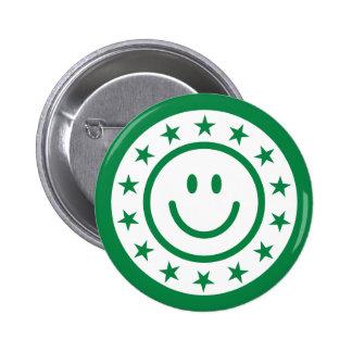 El sello o el sello sonriente feliz verde con las  pins