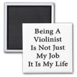 El ser violinista no es apenas mi trabajo que es m imán de frigorífico