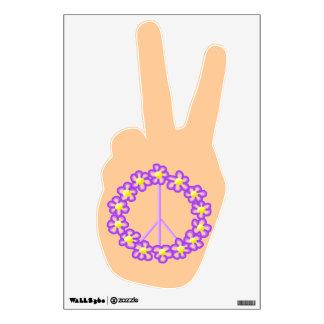 El signo de la paz florece la etiqueta de la pared
