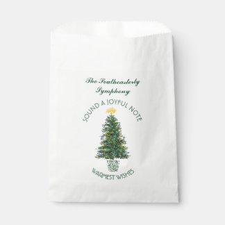 El símbolo de música del árbol de navidad adornó bolsas de recuerdo