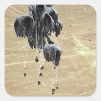 El sistema de envío de envase lía el paracaídas pegatina cuadrada
