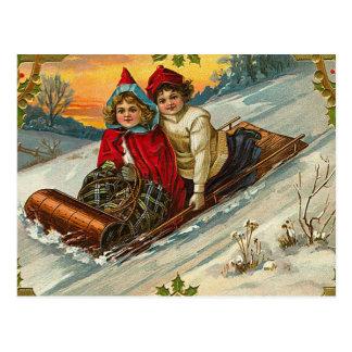 El Sledding de los niños del navidad del Victorian Tarjetas Postales