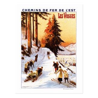 El Sledding y esquí en el poster de los Vosgos Postales