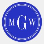 El sobre del monograma del azul real sella etiquet