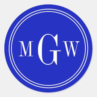 El sobre del monograma del azul real sella etiqueta redonda