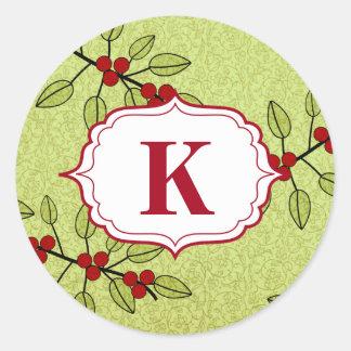 El sobre del monograma del navidad sella verde de pegatina redonda