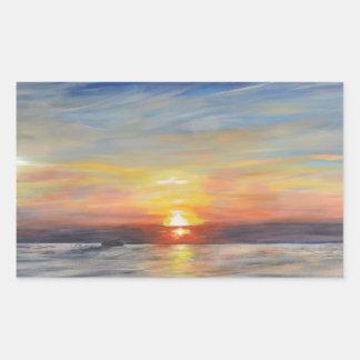 El sol poniente pegatina rectangular