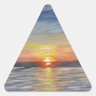 El sol poniente pegatina triangular