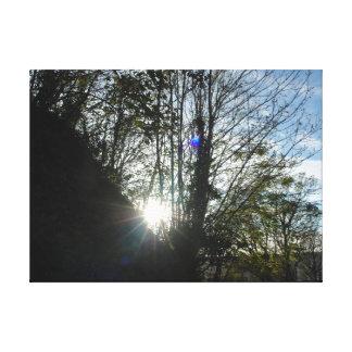 El sol poniente que arruina su manera a través del impresiones de lienzo