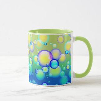 El soplar burbujea la taza III