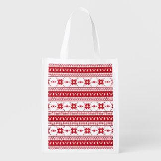 El suéter rojo del navidad inspiró el modelo bolsas para la compra