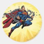 El superhombre rompe cadenas etiqueta redonda