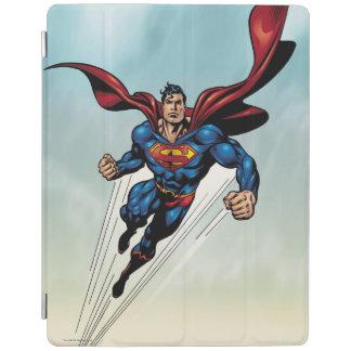 El superhombre salta hacia arriba cubierta de iPad