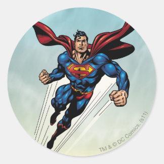 El superhombre salta hacia arriba pegatina redonda