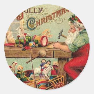 El taller de Santa del navidad del vintage juega l Pegatina Redonda