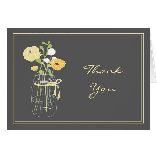 El tarro de albañil gris y amarillo le agradece la felicitacion