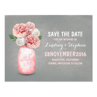 El tarro de albañil pintado y las flores rosadas tarjetas postales