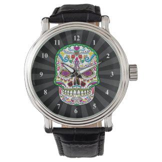 El tatuaje verde florece los cráneos del azúcar reloj