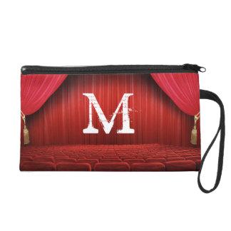 El teatro rojo de la cortina compone el monedero
