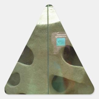 El tejón americano cuida pegatina triangular