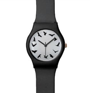 El tiempo vuela el reloj minimalista del pájaro