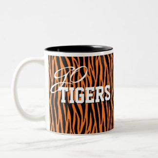 El tigre anaranjado raya la taza de la taza